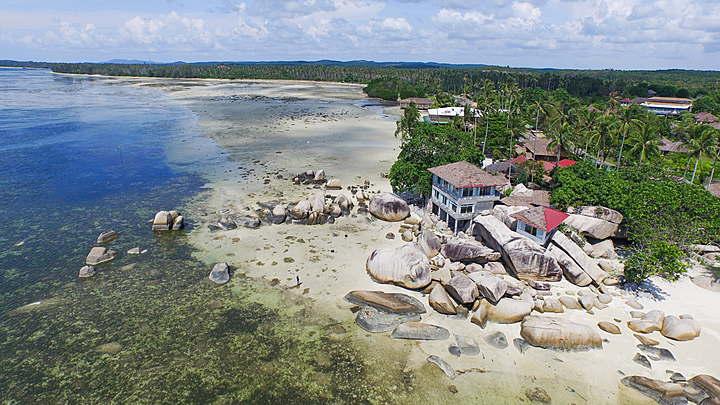 Wisata Pantai Trikora